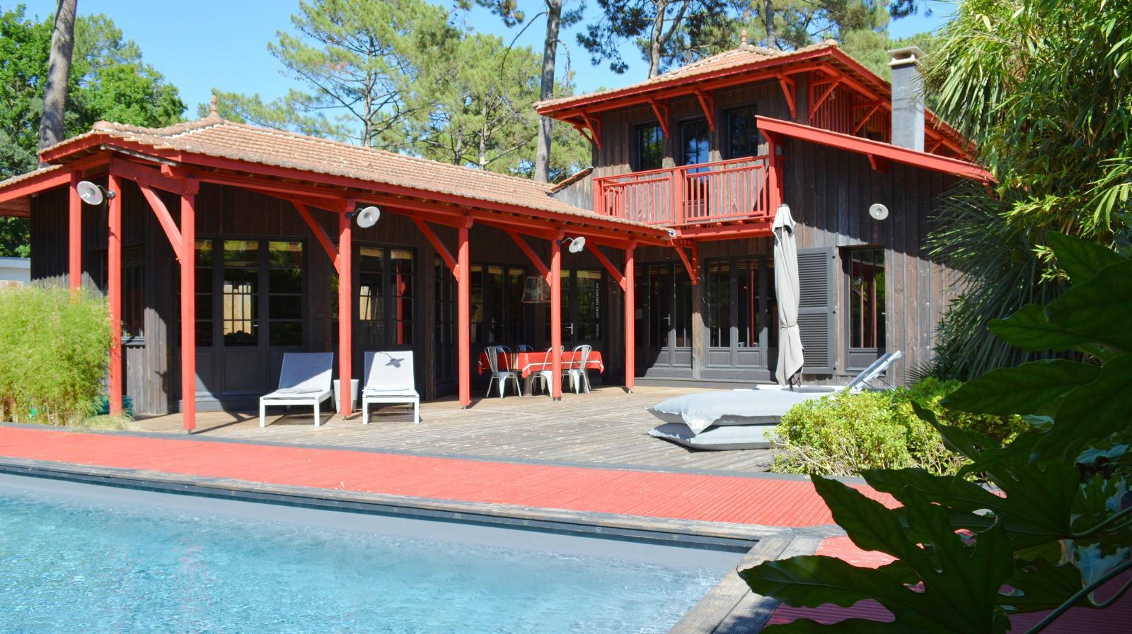Cap ferret magnifique villa en bois avec piscine deux for Maison a louer cap ferret avec piscine