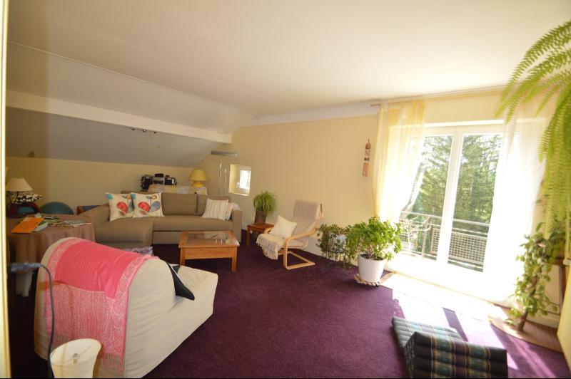 Salon chambre avec balcon