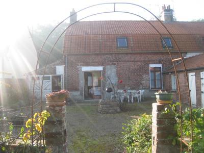 A proximité de Wizernes, maison mitoyenne avec garage et jardin