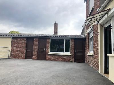 Grande maison avec cour et garage