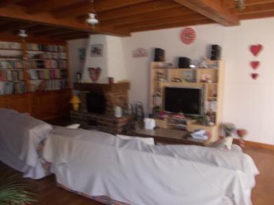 Chaumergy, à vendre ancienne ferme restaurée de 8 pièces, 240m² sur 5093m² de terrain clos., salon/séjour avec cheminée/insert