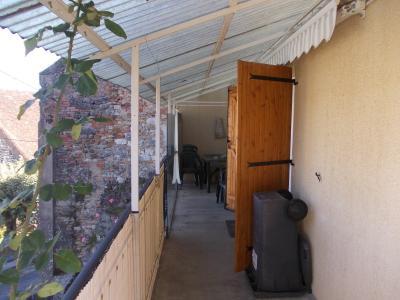 Sellières centre, à vendre maison en pierres de 5 pièces, 120m² habitables avec grande cave voutée., grand balcon terrasse 13m²