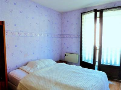 LES ROUSSES 39220 JURA à vendre APPARTEMENT 34.91m²- 1 chambre- dans copropriété bien située., Chambre avec porte-fenêtre sur balcon
